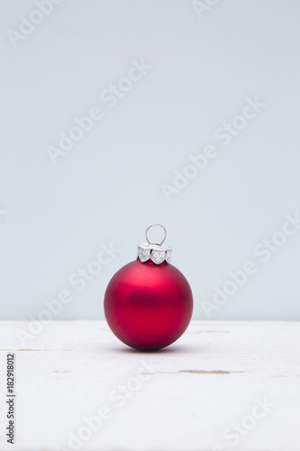 Minimalistic Christmas Scene with a Blue Background on a Distressed Wooden Table Canvas Print