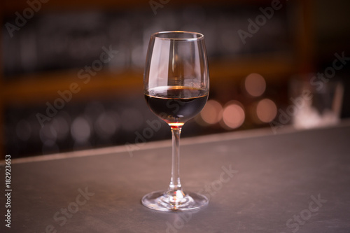 Tuinposter Alcohol Glass of red wine at a bar