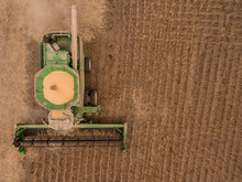 Aerial Of A Combine Harvesting...