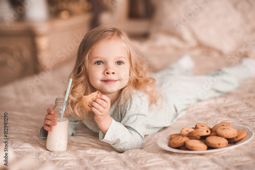 Sweet Baby Girl 3 4 Year Old Eating Cookies And Drinking Milk Lying