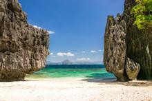 Beach Between Tall Rocks