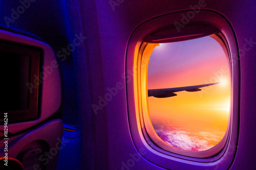 Türaufkleber Flugzeug Beautiful scenic view of sunset through the aircraft window. Image save-path for window of airplane.