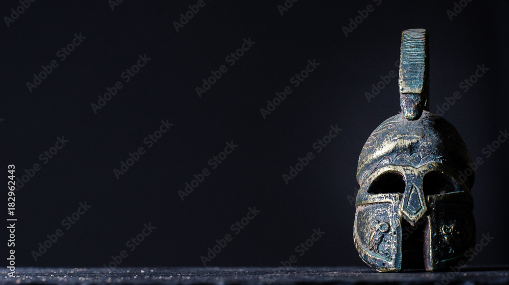 Fototapeta roman helmet on a black background