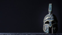 Roman Helmet On A Black Backgr...