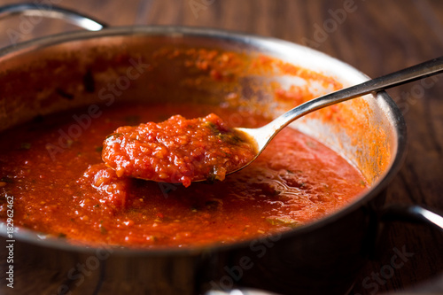 Tomato Sauce with Spoon in Metal Pan Canvas Print