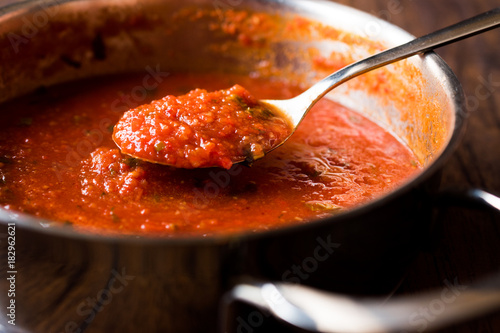 Fotomural  Tomato Sauce with Spoon in Metal Pan