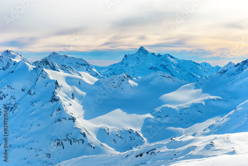 Fototapety, obrazy: Mountains with snow peaks and sunset sky