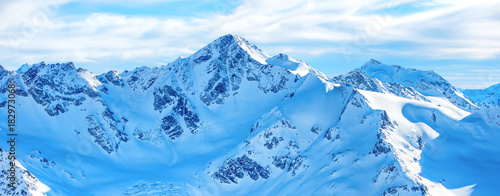 In de dag Panoramafoto s Mountains in snow. Panorama of winter landscape with peaks and blue sky