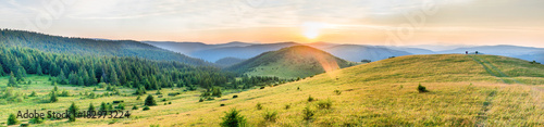 Tuinposter Blauwe hemel Sunset in the mountains