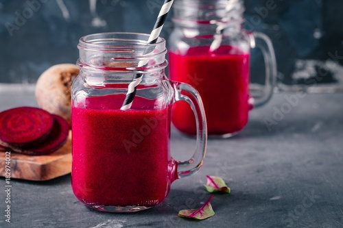 healthy detox beet smoothie with chia seeds in a mason jar on dark background