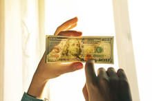 Checking Counterfeit Money Light.