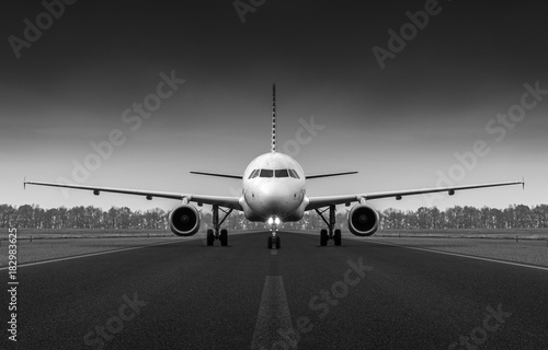 Airplane on the runway preparing to take off Poster