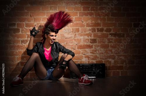 Photo  Punk girl on brick wall background