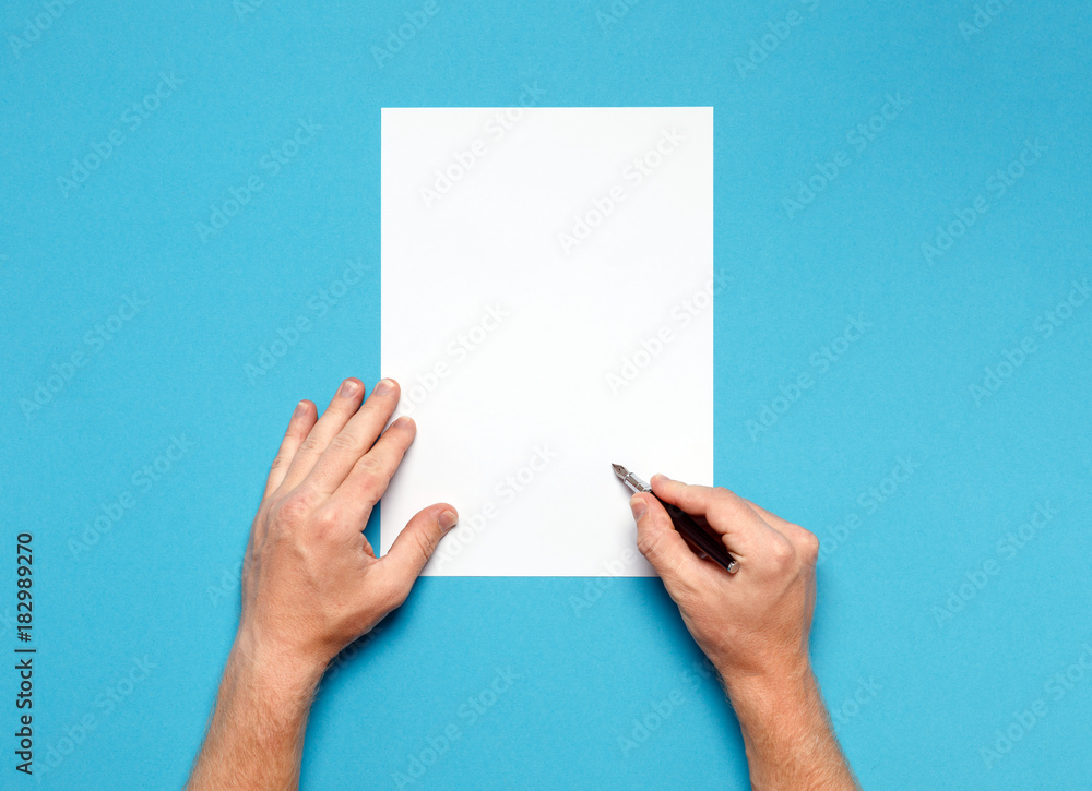 Fototapety, obrazy: Male Hands Is Ready For Drawing With Pen, Top View On Blue Surface. Creativity Concept