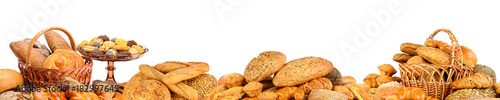 Panorama of fresh bread products isolated on white