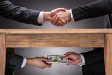 Businesspeople Shaking Hands A...