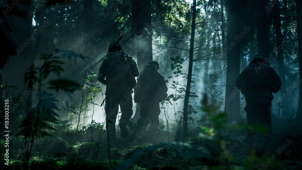 Fototapety, obrazy: Squad of Five Fully Equipped Soldiers in Camouflage on a Reconnaissance Military Mission, Rifles in Firing Position. They're Running in Formation Through Dense Dark Forest. Side View Long Shot.