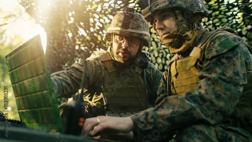 Photo Military Staging Base, Officer Gives Orders to Chief Engineer, They Use Radio and Army Grade Laptop