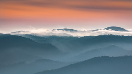 Obraz na SzkleMisty sunrise landscape from Luban peak in Gorce mountains, Poland