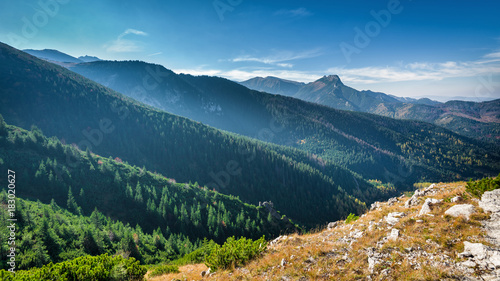 Mountain peak Giewont from between hillocks defile. Tatra mountains, Poland