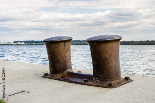 Photo Rusty Bollards on a Dock along the Potomac River in Alexandria, VA on a Cloudy Day
