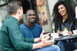 Multiracial group of three friends having a coffee together.