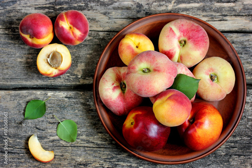 Colorful fruits apricot, nectarine and peach on a wooden table