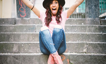 Young Hipster Woman Having Fun Throwing Confetti With Her Hands - Happy Pretty Girl Celebrating Her Gratuation Sitting On Stairs Of Collage - Vignette Edit