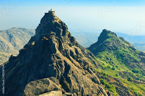 Hindu temple of Lord Dattatreya on top of Guru Dattatreya peak. Girnar Hill, Junagadh, Gujarat, India