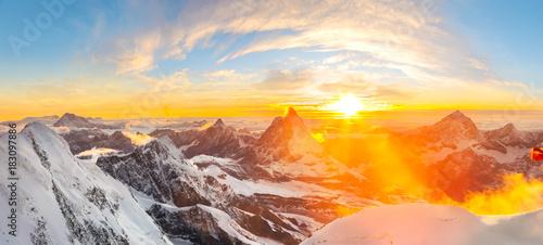 Photo  Sun setting close to Matterhorn