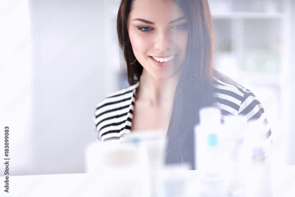 Fototapety, obrazy: Portrait of beautiful young woman in shop
