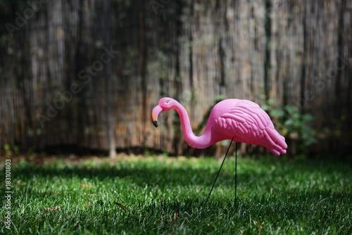 Garden Poster Flamingo Kitschy plastic pink flamingo in green grass