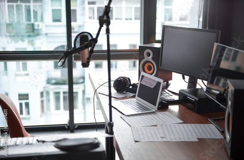 Modern computers, microphone near table in sound recording studio Canvas Print