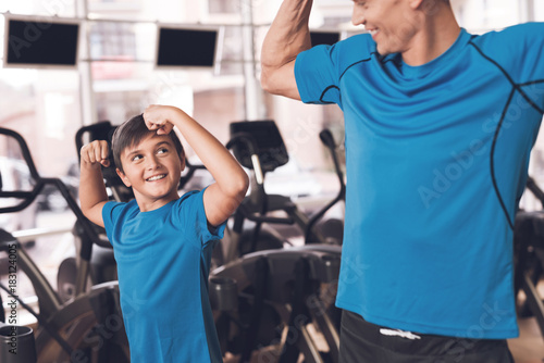 Fototapeta Dad and son in the same clothes in gym. Father and son lead a healthy lifestyle. obraz na płótnie