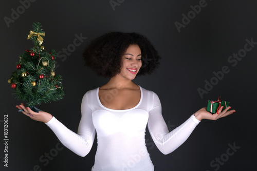 afro american woman with christmas tree Canvas Print
