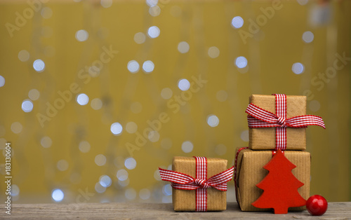 christmas gifts and ornaments golden background