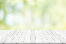 White Table Top On Green Blurred Background,space For Montage Product