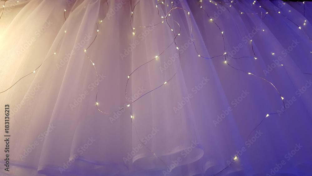 Fototapety, obrazy: Illuminated LED icicle light against sheer fabric background