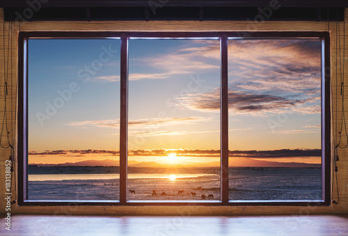 Looking through window in the morning sunrise, wooden window frame with desk
