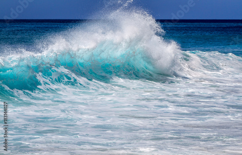 Aqua blue wave on the west side of Oahu Hawaii