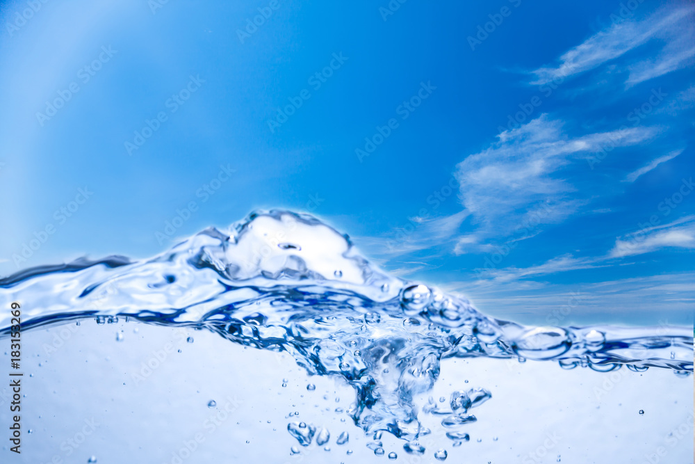 Water and air bubbles under sky background.