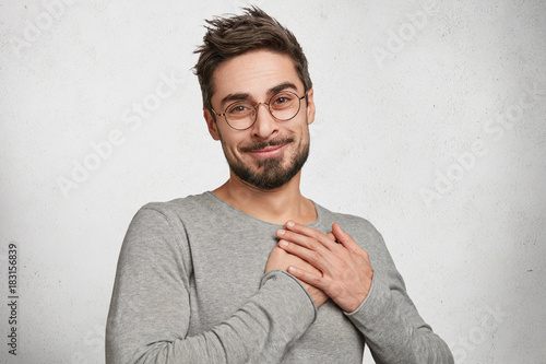 Fotografía  My heart is for you! Pleasant looking male model with appealing appearance demon