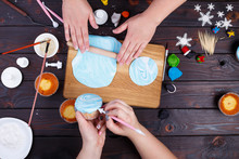 Friends Rolling Confectionery Mastic And Decorating Cupcakes, View From Above. Family Culinary And New Year Traditions Concept, Festive Food, Party Treats, Togetherness, Cooking Process