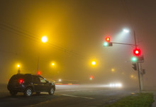 Thick Fog Over Empty Road With...