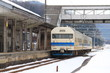 The local train leaving from the local station in the rural area in winter Japan.