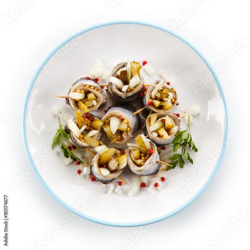 Vászonkép Marinated herring fillets on white background