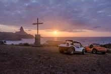 Buggies And Sunset View From Chapel Of Sao Pedro Dos Pescadores With Morro Do Pico On Background - Fernando De Noronha, Pernambuco, Brazil