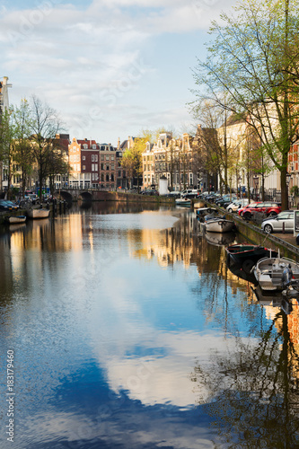Photo  Dutch city scenery with canal and mirror reflections, Amsterdam, Netherlands