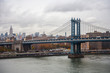 New York view of Manhattan from Brooklyn Bridge Cloudy sky river Industrial landscapes