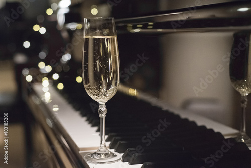a glass of champagne and piano